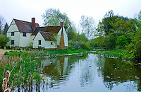 Willy Lots timber framed Suffolk farmhouse, built between 1600 and 1700,  by the mill stream house in Flatford, Suffolk, England
