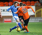 Dundee United v St Johnstone....21.11.15  SPFL,  Tannadice, Dundee<br /> Murray Davidson sclashes with John Rankin and Blair Spittal<br /> Picture by Graeme Hart.<br /> Copyright Perthshire Picture Agency<br /> Tel: 01738 623350  Mobile: 07990 594431