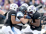 SIOUX FALLS, SD - OCTOBER 27: A trio of defenders including Harvey Enalls #31 from the University of Sioux Falls gang tackle Ryan Parmely #41 from Upper Iowa during their game Saturday at Bob Young Field in Sioux Falls. (Photo by Dave Eggen/Inertia)