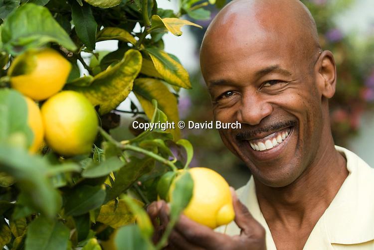 Man holding lemon, portrait