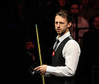 Judd Trump wipes down his cue whilst buying a little time over his next shot during the Dafabet Masters Quarter Final 2 match between Judd Trump and Neil Robertson at Alexandra Palace, London, England on 15 January 2016. Photo by Liam Smith / PRiME Media Images.