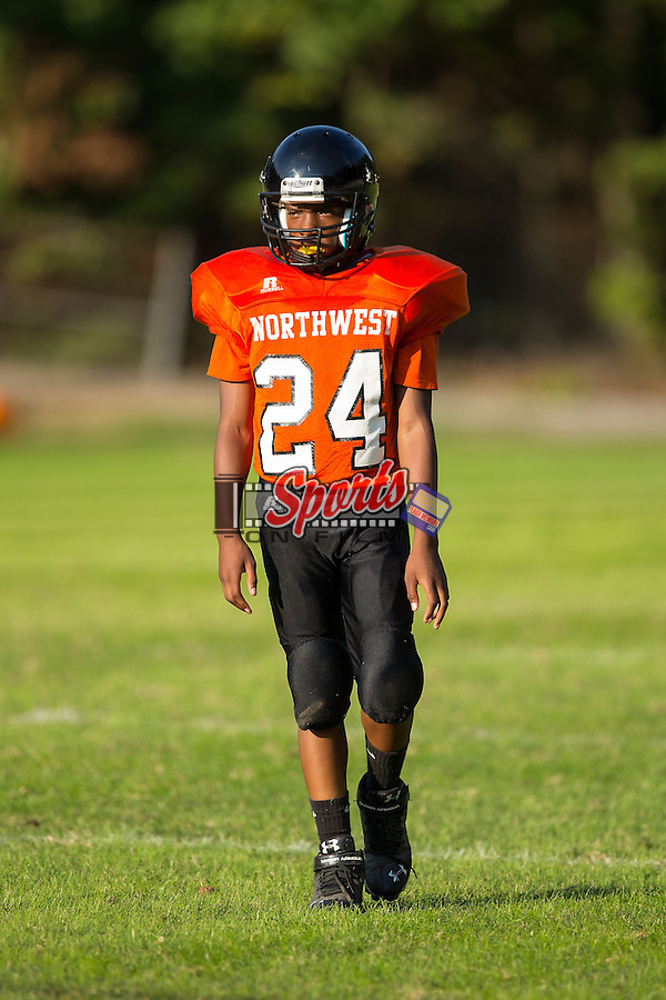 Malik Harris (24) of the Northwest Cabarrus Titans on defense during second half action against the Winkler Wolves at Trojan Stadium October 1, 2014, in Concord, North Carolina.  The Wolves defeated the Titans 24-22.  (Brian Westerholt/Sports On Film)