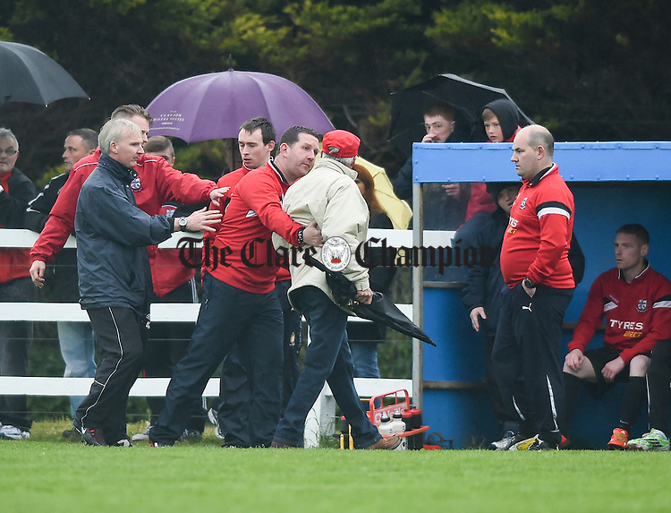 A pitch intruding supporter is dealt with during the Cup final at Doora. Photograph by John Kelly.