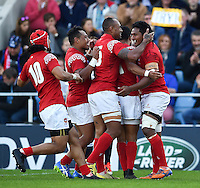 Jack Ram of Tonga is congratulated on his try. Rugby World Cup Pool C match between Tonga and Namibia on September 29, 2015 at Sandy Park in Exeter, England. Photo by: Patrick Khachfe / Onside Images