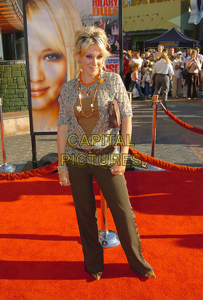 HAYLIE DUFF.'Raise Your Voice' Los Angeles Premiere held at Lowes Universal City 18 Theatre. .Photo: V. Summers/AdMedia.October 3rd, 2004.full length, brown trousers, belt, plunging neckline.www.capitalpictures.com.sales@capitalpictures.com.© Capital Pictures.
