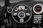 Steering wheel view of a 2010 Mini Cooper Convertible