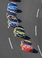 Apr 29, 2007; Talladega, AL, USA; Nascar Nextel Cup Series driver Jeff Gordon (24) leads teammates Casey Mears (25) and Jimmie Johnson (48) during the Aarons 499 at Talladega Superspeedway. Mandatory Credit: Mark J. Rebilas