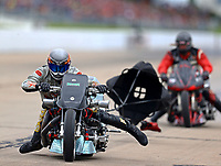 May 20, 2017; Topeka, KS, USA; NHRA top fuel nitro Harley Davidson rider Frank Capone Jr (left) comes across the track in front of Julian Seeman during qualifying for the Heartland Nationals at Heartland Park Topeka. Mandatory Credit: Mark J. Rebilas-USA TODAY Sports