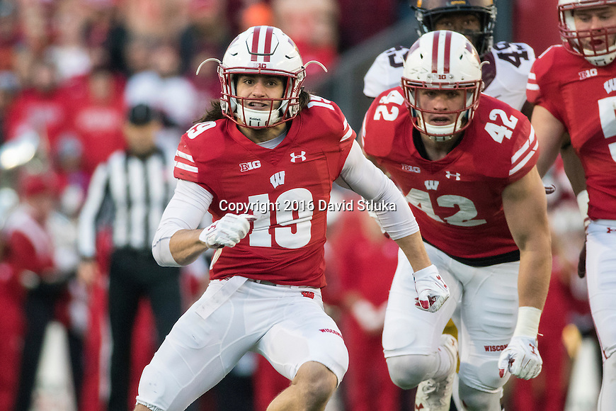 Wisconsin Badgers defensive back Leo Musso and linebacker T.J. Watt (42) run downfield on punt coverage during an NCAA Big Ten Conference college football game against the Minnesota Golden Gophers Saturday, November 26, 2016, in Madison, Wis. The Badgers won 31-17. (Photo by David Stluka)