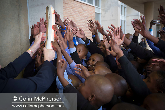 The Queen's Baton arrived in Lesotho on 11 May, 2017, on the first of four days in the country, where it was welcomed welcomed to the mountain kingdom by King Letsie III of Lesotho. This Queen's Baton Relay will visit all 70 nations and territories of the Commonwealth, over 388 days and cover 230,000km. It will be the longest Relay in Commonwealth Games history, finishing at the Opening Ceremony on the Gold Coast on 4th April 2018. Photograph shows a group of school pupils greeting the Baton as it arrives at the country's airport.