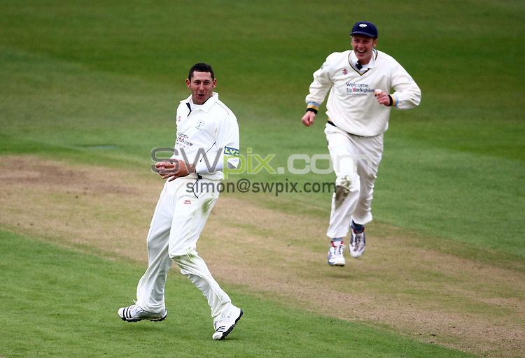PICTURE BY VAUGHN RIDLEY/SWPIX.COM - Cricket - County Championship - Yorkshire v Somerset, Day 1 - Headingley, Leeds, England - 15/04/10...Copyright - Simon Wilkinson - 07811267706...Yorkshire's Tim Bresnan (L) celebrates catching Somerset's Jame Hildreth out lbw.  Andrew Gale (R)