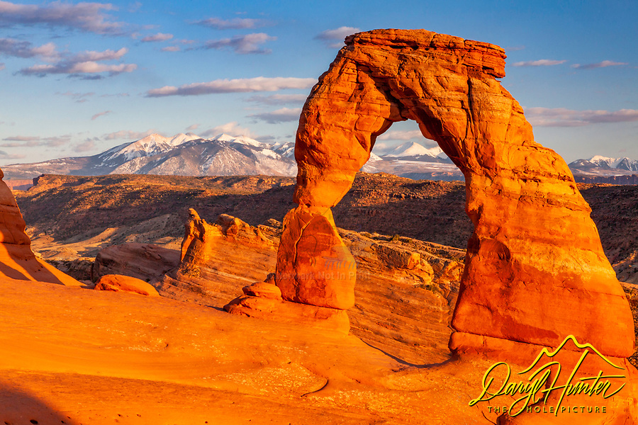 Delicate Arch approaching sunset and the snowy La Sal Mountains.  I love the juxtaposition of the desert sandstone in the foreground and the alpine landscape behind it.  A touch of evening light to make them glow.  Delicate Arch is the Iconic landmark of the State of Utah.