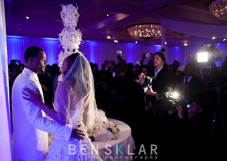 Ross and Richards are instructed by camera crews during the cake cutting. The reality tv show Platinum Weddings filmed the event.Olympic gold medalist, Sanya Richards, and New York Giants cornerback, Aaron Ross, wed at the Hyde Park Baptist in Austin, Texas on Friday, February 26, 2010...
