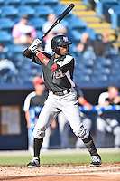 Hickory Crawdads second baseman Travis Demeritte (25) swings at a pitch during game one of a double header against the Asheville Tourists on April 21, 2015 in Asheville, North Carolina. The Crawdads defeated the Tourists 10-1. (Tony Farlow/Four Seam Images)