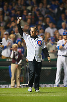 Chicago Cubs Hall of Fame member Greg Maddux waves to the crowd before throwing out the ceremonial first pitch during Game 4 of the Major League Baseball World Series against the Cleveland Indians on October 29, 2016 at Wrigley Field in Chicago, Illinois.  (Mike Janes/Four Seam Images)