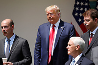 United States President Donald J. Trump leaves the podium after signing H.R. 7010 - PPP Flexibility Act of 2020 in the Rose Garden of the White House in Washington on June 5, 2020. From left to right: US Secretary of Labor Eugene Scalia; the president; US Vice President Mike Pence; and Tomas Philipson, Chairman of the Council of Economic Advisers.<br /> Credit: Yuri Gripas / Pool via CNP/AdMedia