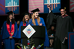 Left to right, Kayla Raelle Holder, Class of 2016, Angela De Venuto, Class of 2011, Elsa Rose Guenther, student speaker, and John Culbert, dean of The Theatre School, induct the graduating students into the Alumni Association Saturday, June 10, 2017, during the DePaul University School of Music and The Theatre School commencement ceremony at the Rosemont Theatre in Rosemont, IL. (DePaul University/Jeff Carrion)