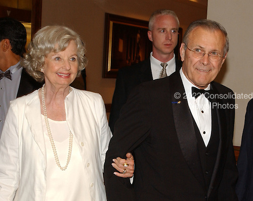 Washington, DC - May 1, 2004 -- United States Secretary of Defense Donald Rumsfeld, right, and his wife, Joyce, left, arrives for the 2004 White House Correspondents Association Dinner in Washington, D.C. on May 1, 2004..Credit: Ron Sachs / CNP.(RESTRICTION: No New York Metro or other Newspapers within a 75 mile radius of New York City)