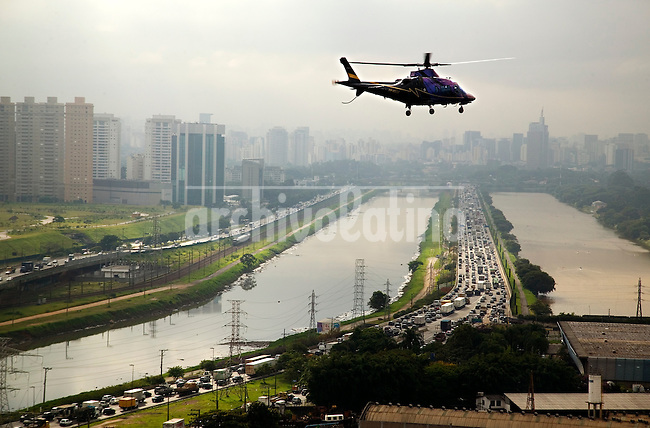 Typical traffic jam in Sao Paulo: one of the main reasons why those with money, unwilling to waste hours a day locked between exhaustion pipes and the threatening urban violence, are switching to helicopters instead.It takes only 7 minutes to fly from Alphaville, an up-market residential area at the outskirts of Sao Paulo, to Avenida Paulista, the financial heart of the city. By car the same distance could take up to 2 hours, during rush hour