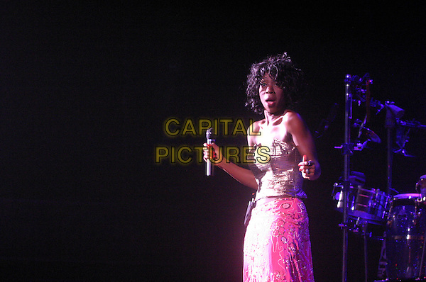HEATHER SMALL .M People .plays Nottingham Arena..UK, United Kingdom..Ref: JEZ.30th September 2005.half length M People live on stage performing gig sing singing mpeople m-people holding microphone pastel pink strapless boobtube silk satin.www.capitalpictures.com.sales@capitalpictures.com.©Capital Pictures.