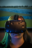 Angela Cook uses an HTC Vive Virtual Reality (VR) system to explore a hypothetical future Kenai, Alaska. Cook, an undergraduate researcher studying under Frank Witmer in UAA's Computer Science and Engineering Department, has used 3D Modeling software to design explorable future scenarios for the Kenai Watershed in a project funded by the National Science Foundation's (NSF) Established Program to Stimulate Competitive Research (EPSCoR).