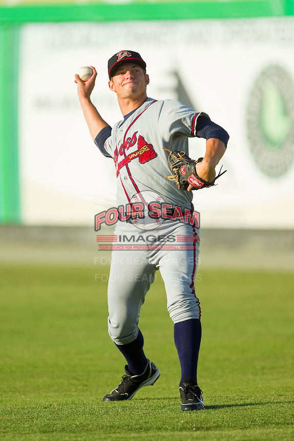 Danville Braves starting pitcher Andrew Waszak (36) warms up in the outfield prior to the game against the Burlington Royals at Burlington Athletic Park on August 16, 2013 in Burlington, North Carolina.  The Royals defeated the Braves 1-0.  (Brian Westerholt/Four Seam Images)