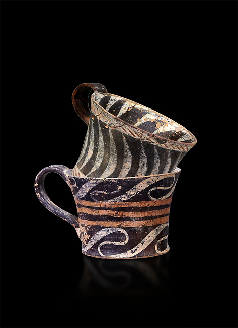 """Minoan Kamares """"eggshell"""" ware cups with  with  polychrome decorations, from set found at Phaistos Palace 1800-1600 BC; Heraklion Archaeological  Museum, black background.<br /> <br /> These cups found as parts of sets in Phaistos palace were names """"eggshell"""" ware due to the very thin walls of the cups. This style of pottery is named afetr Kamares cave where this style of pottery was first found"""