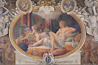 Fresco of Danae with Jupiter represented by a golden shower (together they will have a son, Perseus), the only fresco in this gallery by Francesco Primaticcio, 1504-70, in the Galerie Francois I, begun 1528, the first great gallery in France and the origination of the Renaissance style in France, Chateau de Fontainebleau, France. The Palace of Fontainebleau is one of the largest French royal palaces and was begun in the early 16th century for Francois I. It was listed as a UNESCO World Heritage Site in 1981. Picture by Manuel Cohen