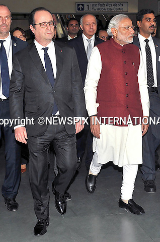25.01.2016; Delhi, India: PRESIDENT HOLLANDE OF FRANCE AND INDIAN PM NARENDRA MODI<br /> travel on the Delhi to Gurgaon.<br /> The French President in the guest of honour for the Republic Day celebrations on the 26th of January 2016.<br /> Mandatory Credit Photos: &copy;NEWSPIX INTERNATIONAL<br /> <br /> PHOTO CREDIT MANDATORY!!: NEWSPIX INTERNATIONAL(Failure to credit will incur a surcharge of 100% of reproduction fees)<br /> <br /> IMMEDIATE CONFIRMATION OF USAGE REQUIRED:<br /> Newspix International, 31 Chinnery Hill, Bishop's Stortford, ENGLAND CM23 3PS<br /> Tel:+441279 324672  ; Fax: +441279656877<br /> &quot;All fees payable to &quot;Newspix International&quot;<br /> e-mail: info@newspixinternational.co.uk