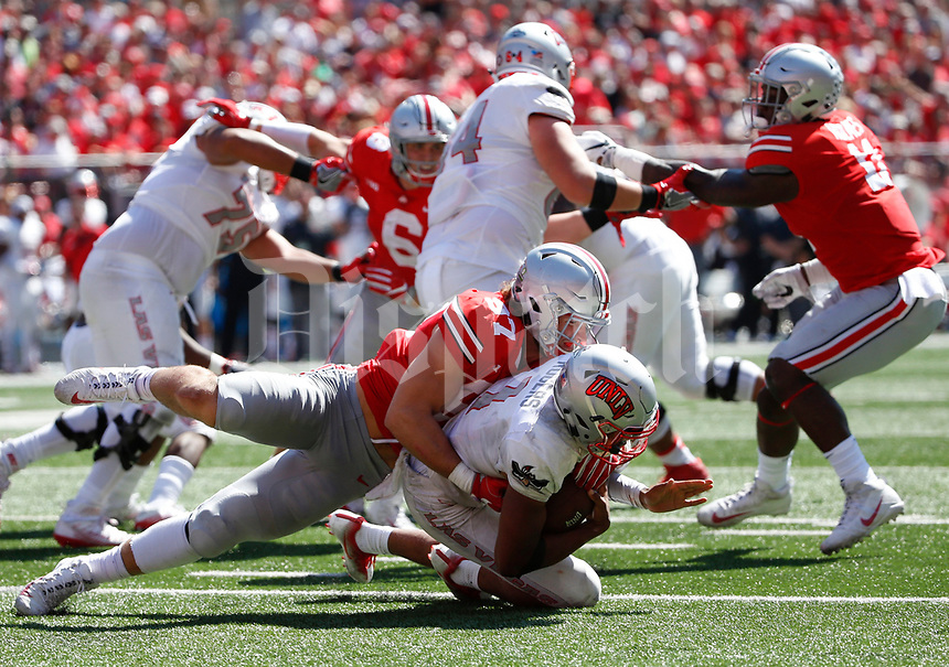 Ohio State Buckeyes defensive lineman Nick Bosa (97) sacks UNLV Rebels quarterback Armani Rogers (1) during the second quarter of a NCAA college football game between the Ohio State Buckeyes and the UNLV Rebels on Saturday, September 23, 2017 at Ohio Stadium in Columbus, Ohio. [Joshua A. Bickel/Dispatch]