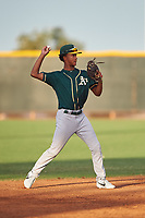 AZL Athletics Green shortstop Jalen Greer (4) throws to first base during an Arizona League game against the AZL Reds on July 21, 2019 at the Cincinnati Reds Spring Training Complex in Goodyear, Arizona. The AZL Reds defeated the AZL Athletics Green 8-6. (Zachary Lucy/Four Seam Images)