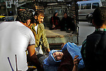 Civilians, injured by mortar shells, are treated at a local clinic in the heart of Aleppo city on Tuesday, October 9, 2012. ..© Javier Manzano..