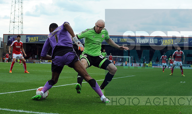 Conor Sammon of Sheffield United is challenged by Swindon Town goalkeeper Lawrence Vigouroux<br /> - English League One - Swindon Town vs Sheffield Utd - County Ground Stadium - Swindon - England - 29th August 2015