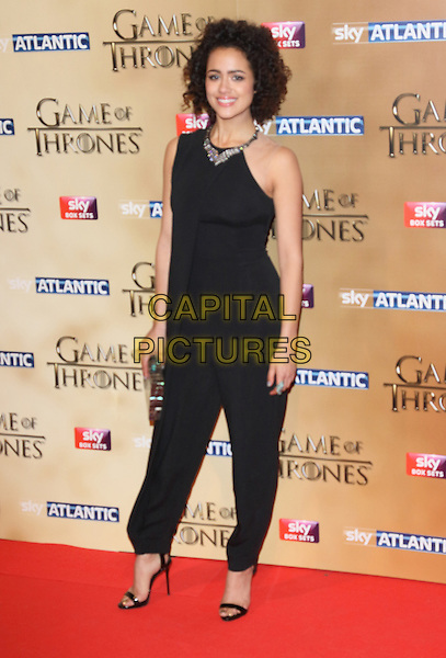 LONDON, ENGLAND - MARCH 18: Nathalie Emmanuel arrives for the world premiere of Game of Thrones Season 5 at Tower of London on March 18, 2015 in London, England<br /> CAP/ROS<br /> &copy; Steve Ross/Capital Pictures