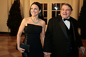 Actress Julia Louis-Dreyfus, left, and William Louis-Dreyfus arrive to a state dinner hosted by U.S. President Barack Obama and first lady Michelle Obama in honor of French President Francois Hollande at the White House in Washington, D.C., U.S., on Tuesday, Feb. 11, 2014. Obama and Hollande said the U.S. and France are embarking on a new, elevated level of cooperation as they confront global security threats in Syria and Iran, deal with climate change and expand economic cooperation. <br /> Credit: Andrew Harrer / Pool via CNP