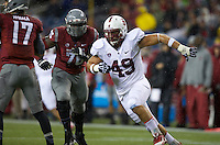 SEATTLE, WA - September 28, 2013: Stanford defensive end Ben Gardner rushes the quarterback during play against Washington State at CenturyLink Field. Stanford won 55-17