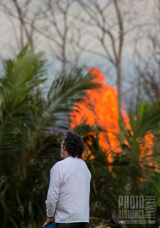 May 2018: A man stands near the path of the Kilauea Volcano eruption in Leilani Estates, Puna, Big Island of Hawai'i.