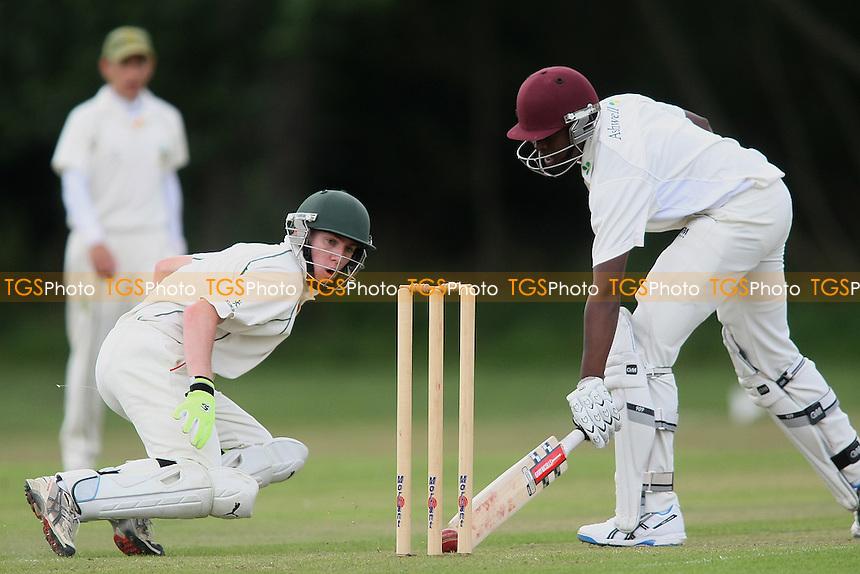 Jamal Francis of Gidea Park-Gidea Park CC v Belhus CC - Essex Cricket League - 28/07/12 - MANDATORY CREDIT: George Phillipou/TGSPHOTO - Self billing applies where appropriate - 0845 094 6026 - contact@tgsphoto.co.uk - NO UNPAID USE.