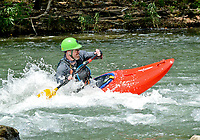Janelle Jessen/Herald-Leader<br /> William Dupree of Pack Rat Outdoor Center in Fayetteville played in the current on the Illinois River in the Siloam Springs Kayak Park on Thursday. The park is a popular destination, especially during the summer months.
