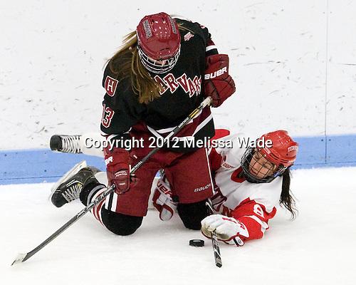 Kalley Armstrong (Harvard - 13), Kayla Tutino (BU - 8) - The Boston University Terriers defeated the visiting Harvard University Crimson 2-1 on Sunday, November 18, 2012, at Walter Brown Arena in Boston, Massachusetts.