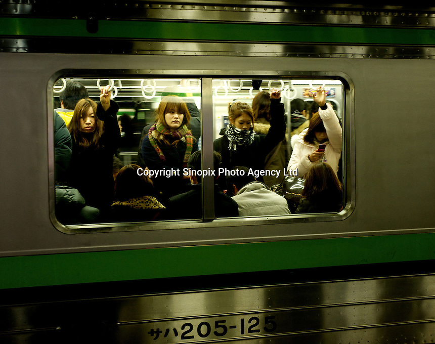 Passengers returning home on a commuter train in Yokohama, Japan. The Yokohama subway consists of Line 1, Line3 and Line 4; Line 2 was planned but cancelled. They are administered by the Yokohama City Transportation Bureau..12 Jan 2011