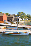 Mystic Seaport and historic 19th century village museum. Shorefront with docks and dory boats display.