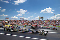 Jun. 2, 2013; Englishtown, NJ, USA: NHRA top fuel dragster driver Brittany Force (near lane) races alongside Spencer Massey during the Summer Nationals at Raceway Park. Mandatory Credit: Mark J. Rebilas-
