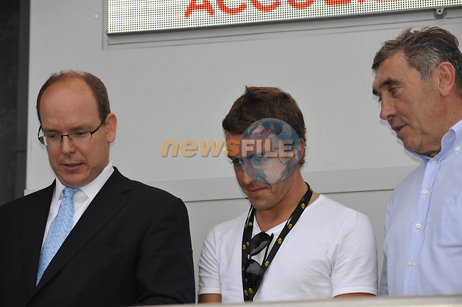 L-R  Prince Albert of Monaco, F1 driver Fernando Alonso and former winner Eddy Merckx on the podium at the end of the Prologue Stage 1 of the 2009 Tour de France a 15.5km individual time trial held around Monaco. 4th July 2009 (Photo by Eoin Clarke/NEWSFILE)