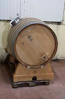 Fermentation in barrel. Oak barrel aging and fermentation cellar. Chateau Liversan, Domaines Lapalu, Haut Medoc, Bordeaux, France