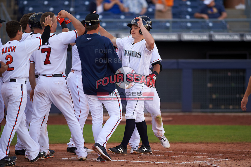 Peoria Javelinas outfielder Tyler O'Neill (4) high fives teammates after hitting a walk off home run during an Arizona Fall League game against the Mesa Solar Sox on October 21, 2015 at Peoria Stadium in Peoria, Arizona.  Peoria defeated Mesa 5-3.  (Mike Janes/Four Seam Images)