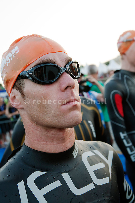 A professional triathlete prepares start the 2012 Ironman at 6.25 am with a 3.8 km swim in the sea, Nice, France, 24 June 2012