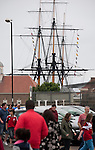 The Trincomalee, an historic floating warship permanently moored in Hartlepool marina, provides the backdrop as supporters of Hartlepool United and Middlesbrough make their way to the Victoria Ground, Hartlepool, before the pre-season friendly between the two teams. Hartlepool were relegated to League Two at the end of the 2012-13 season whilst their Teesside neighbours remained two divisions above them in the Championship. The game ended in a no-score draw, the home team's goalkeeper Scott Flinders saving a second-half penalty from Boro's Lucas Jutkiewicz, watched by a crowd of 2307.