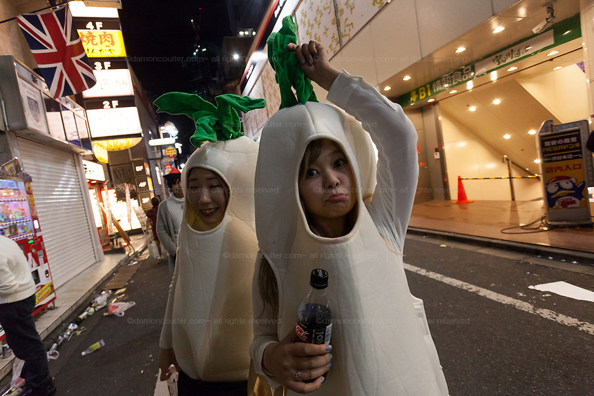 Two Japanese women dressed as radishes during the Halloween celebrations Shibuya, Tokyo, Japan. Saturday October 27th 2018. The celebrations marking this event have grown in popularity in Japan recently. Enjoyed mostly by young adults who like to dress up, drink , dance and misbehave in parts of Tokyo like Shibuya and Roppongi. There has been a push back from Japanese society and the police to try to limit the bad behaviour.