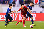 Do Hung Dung of Vietnam (C) fights for the ball with Nagatomo Yuto of Japan (R) and Haraguchi Genki of Japan (L) during the AFC Asian Cup UAE 2019 Quarter Finals match between Vietnam (VIE) and Japan (JPN) at Al Maktoum Stadium on 24 January 2018 in Dubai, United Arab Emirates. Photo by Marcio Rodrigo Machado / Power Sport Images